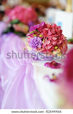 Wedding table decorated with a purple flowers