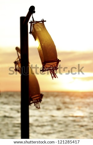 wedding table decoration in open air restaurant on beach at sunset