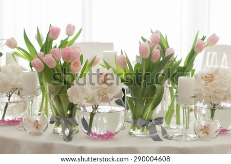 Wedding Table Decoration. Table set for a wedding dinner. Beautiful flowers on table in wedding day