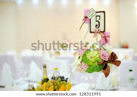 wedding table decoration with flower composition