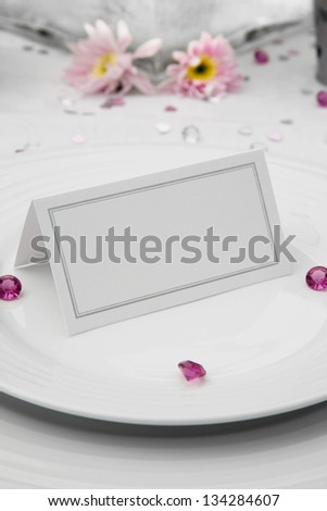 Wedding Table display with a blank place card on bone china plates