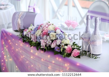 Wedding table for newlyweds with flowers in pink and purple colors