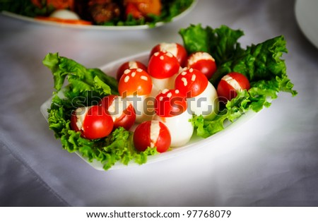 Wedding table salad - mushrooms made out of eggs and tomatoes