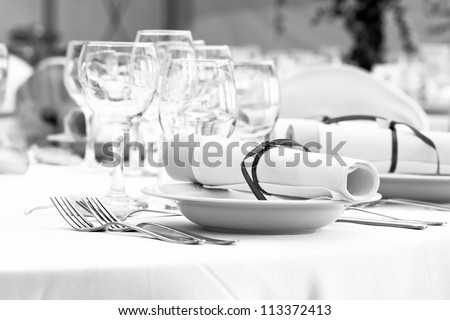 wedding table set for fine dining or another catered event - black and white