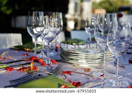 Wedding table set outdoor.\\ Table decorated for the wedding party covered with beautiful red flowers.