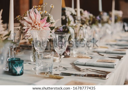 Wedding table set up, flowers and arrangements  Stockfoto ©