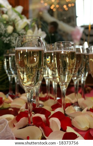stock photo wedding table setting Champagne rose petals