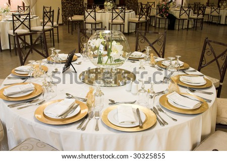 Wedding Table Setting With Golden Coloured Plates Stock Photo