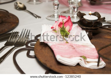 stock photo Wedding Table setting with rusted colors and pink flowers