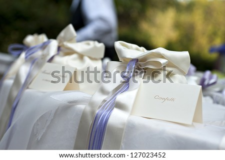 wedding table with bags of confetti