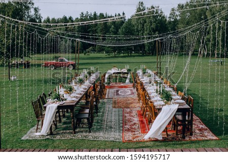 Wedding tables set for a party in the countryside, nobody around