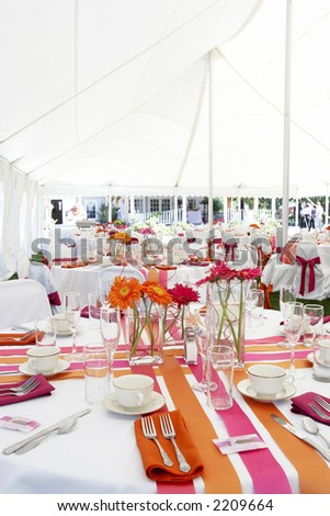 stock photo wedding tables set for fine dining during an event outside