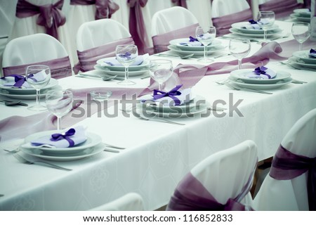 wedding tables set for fine dining or another catered event - colorized photo