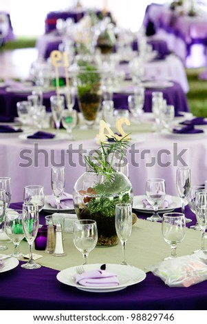 Wedding Tables Set Up For Fine Dining In Green And Purple, Unique ...