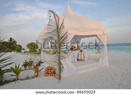 Wedding tent in the maldives at sunset