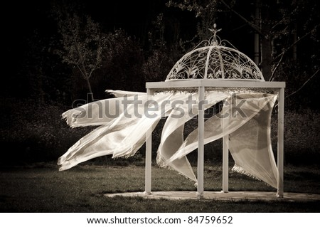 Wedding tent, wind blowing soft veil.