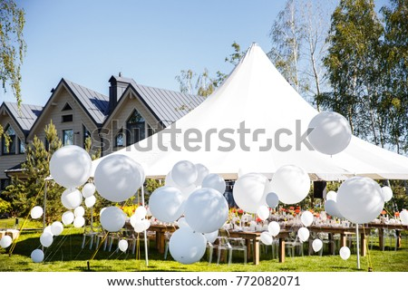 Wedding tent with large balls. Tables sets for wedding or another catered event dinner. #772082071