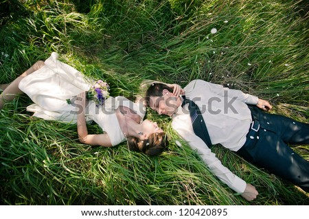 wedding theme, beautiful wife and husband are on the green grass
