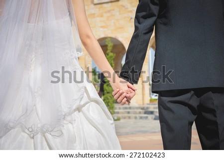 wedding theme, holding hands newlyweds #272102423