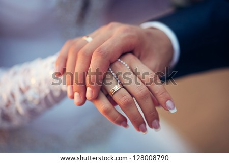 wedding theme, man and woman holding hands with a nice manicure neat