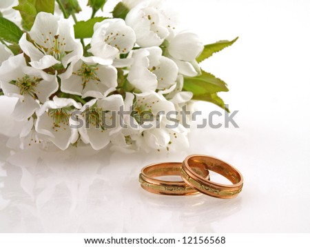 Wedding. Wedding card. Wedding. wedding flowers. Wedding rings and spring flowers / Wedding Rings,Wedding Rings. Wedding still life. Wedding card with wedding rings. Wedding rings and cherry blossoms.