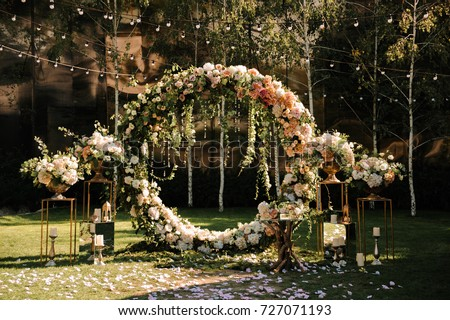 Wedding. Wedding ceremony. Arch. Arch, decorated with pink and white flowers standing in the woods, in the wedding ceremony area - Shutterstock ID 727071193