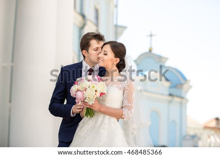 Wedding. Wedding day. Beautiful bride and elegant groom walking after wedding ceremony. Luxury bridal dress and bouquet of flowers. Bride and groom at wedding day #468485366