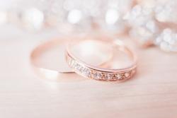 Wedding wedding rings on a light background, selective focus, macro