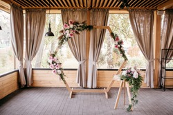 wedding wooden arch with flowers