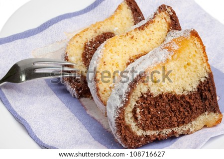 Wedges of marbel cake on a plate with fork