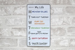 Week of My Life White Board on Brick wall with Weekday Sayings
