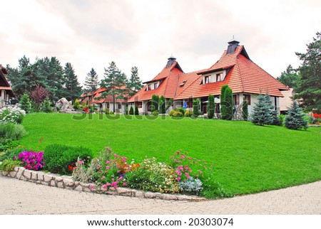 weekend houses with gardens and stone road in Serbia, Zlatibor - stock photo