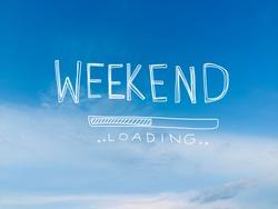 Weekend loading word on beautiful blue sky and cloud