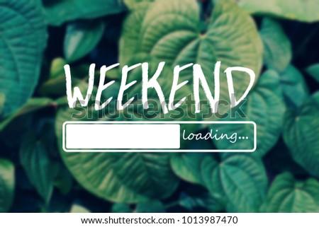 Weekend loading word on green leaves background