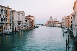 Weekend trip to the Venice. Icon view from the quit water of grand canal and cathedral in the sunset lights. Postcard from italian holidays. Empty Venice, nobody concept.