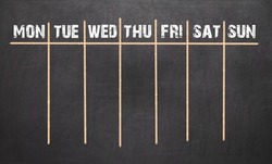 Weekly Calendar on chalkboard background. 7 day plan