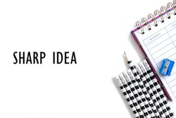 Weekly organizer planner, shaper and sharp pencil surrounded by dull pencils and words SHARP IDEA on white bakcground. Stationery flat lay. Business, sharp ideas concept