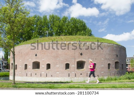 Weesp, Netherlands - May 21, 2015: Fort on the Ossenmarkt: old fortress tower is heart of the fortress Weesp, Netherlands