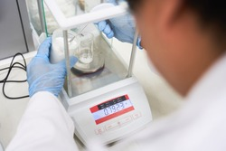 Weighing of raw materials in  chemical laboratory, Laboratory technician at work