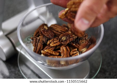 Weighing Pecan Nuts on Kitchen Scale. Making Chocolate, Pear and Pecan Pie Series.