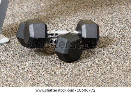 Weight bench at the gym with dumb bells