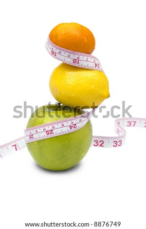 Weight loss and healthy dieting concept. Apple, lemon and mandarin with measure tape. Isolated over white.