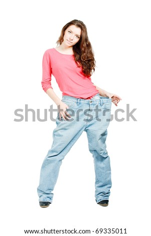 weight loss beautiful foxy woman in too great jeans trousers isolated over white