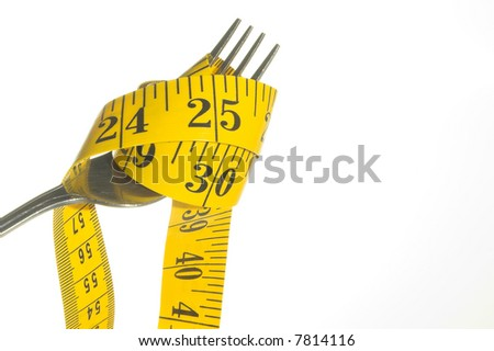 Weight Loss Concept - A tailor's tape pouring into a drinking glass.