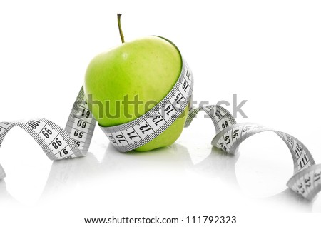 weight loss concept. Apple and measuring tape on white background. Diet.