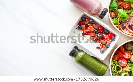 Weight loss diet fresh organic meal delivery service containers in healthy food take away eco boxes and smoothie on marble white background, daily lunchbox ready menu plan concept. Flat lay top view.