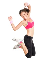 Weight loss fitness woman jumping of joy. Young sporty fit mixed race Asian / Caucasian female model isolated on white background in full body