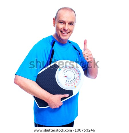 Weight loss. Happy senior man with scales. Isolated over white.