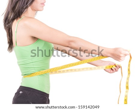weight loss  hispanic woman smiling with measuring tape