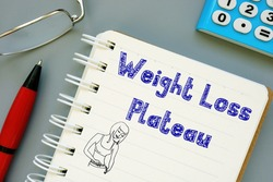 Weight Loss Plateau inscription on the piece of paper.
